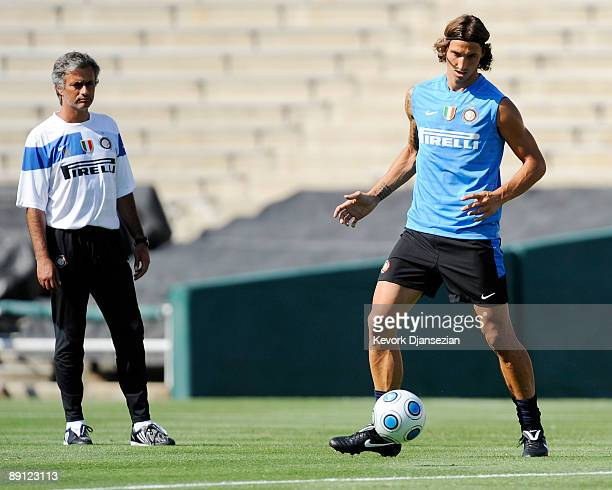 Zlatan Ibrahimovic striker of Inter Milan walks trains as coach Jose Mourinho looks on during team practice at the Rose Bowl stadium on July 20 2009...