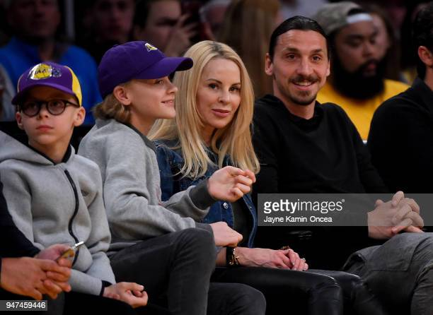 Zlatan Ibrahimoviu008d of the Los Angeles Galaxy attends the game between the Los Angeles Lakers and the Minnesota Timberwolves with his wife Helena...