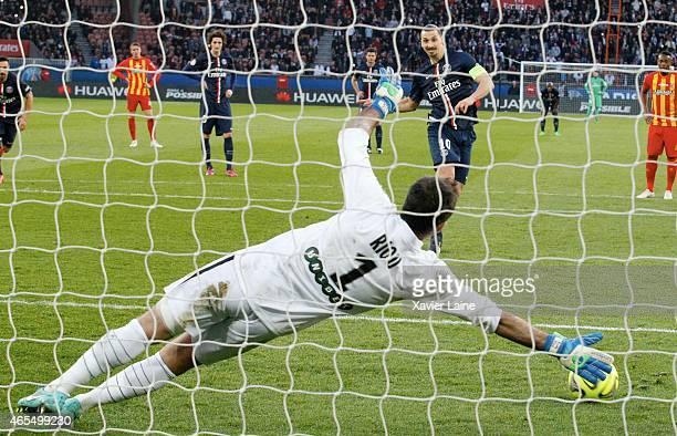 Zlatan Ibrahmovic of Paris SaintGermain scores a goal during the French Ligue 1 match between Paris SaintGermain FC and RC Lens at Parc Des Princes...