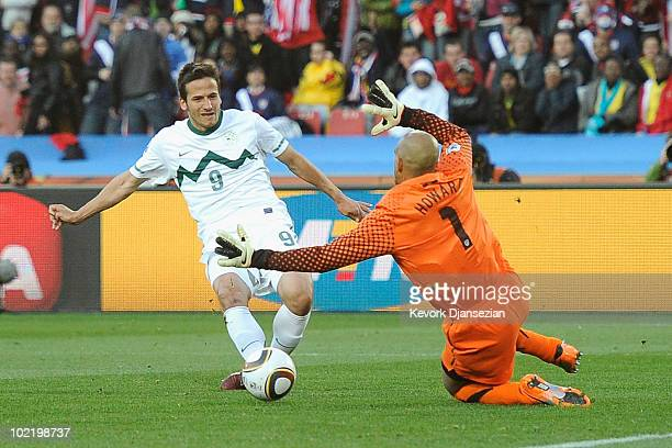 Zlatan Ljubijankic of Slovenia scores his side's second goal past Tim Howard of the United States during the 2010 FIFA World Cup South Africa Group C...