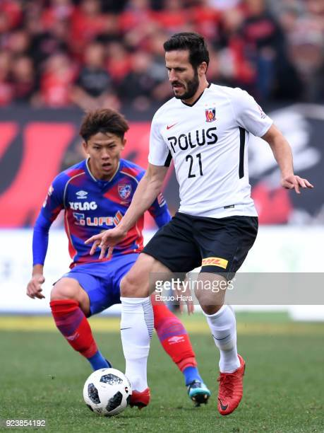 Zlatan Ljubijankic of Urawa Red Diamonds and Kosuke Ota of FC Tokyo compete for the ball during the JLeague J1 match between FC Tokyo and Urawa Red...