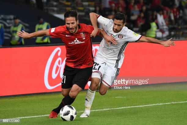 Zlatan Ljubijankic of Urawa Red Diamonds and Salem Abdulla compete for the ball during the FIFA Club World Cup match between Al Jazira and Urawa Red...
