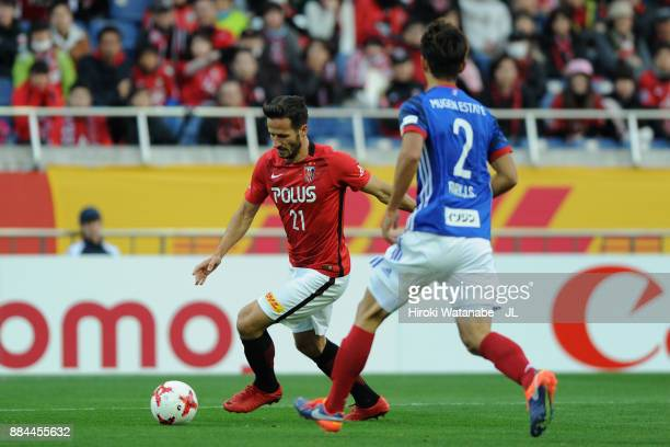 Zlatan Ljubijankic of Urawa Red Diamonds takes on Park Jeongsu of Yokohama FMarinos during the JLeague J1 match between Urawa Red Diamonds and...