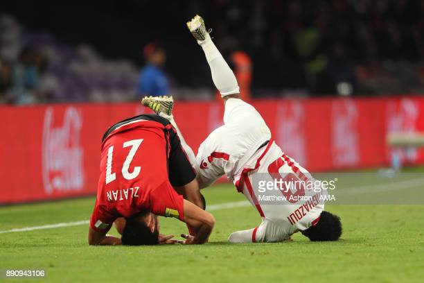Zlatan Ljubijankic of Urawa Red Diamonds tangles with Amin Tighazoui of Wydad Casablanca during the FIFA Club World Cup UAE 2017 fifth place playoff...