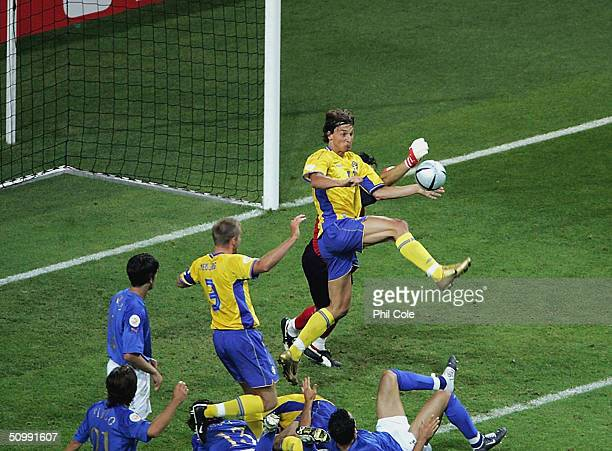 Zlaten Ibrahimovic of Sweden scores the equaliser against Italy during the UEFA Euro 2004 Group C match between Italy and Sweden on June 18, 2004 at...