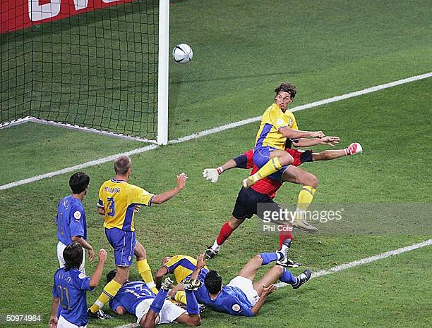 Zlaten Ibrahimovic of Sweden scores the equiliser against Italy during the UEFA Euro 2004 Group C match between Italy and Sweden at the Estadio...
