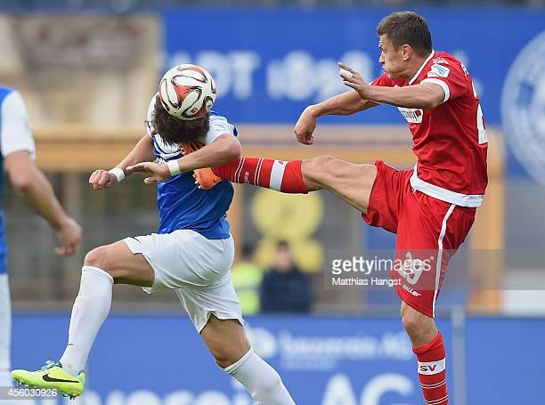 Zlatko Dedic of Frankfurt hits Romain Bregerie of Darmstadt in the face during the Second Bundesliga match between SV Darmstadt 98 and FSV Frankfurt...