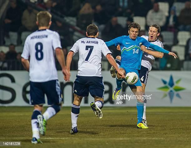 Zlatko Dedic of Slovenia vies with Christoph Berra of Scotland during the friendly football match Slovenia vs Scotland at Stadium Bonifika in Koper...