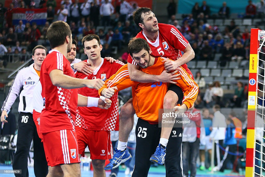Zlatko Horvat, Marino Maric, Mirko Aillovic and Domagoj Duvnjak of Croatia celebrate after the Men's Handball World Championship 2013 third place match between Slovenia and Croatia at Palau Sant Jordi on January 26, 2013 in Barcelona, Spain. The match between Slovenija and Croatia ended 26-31.