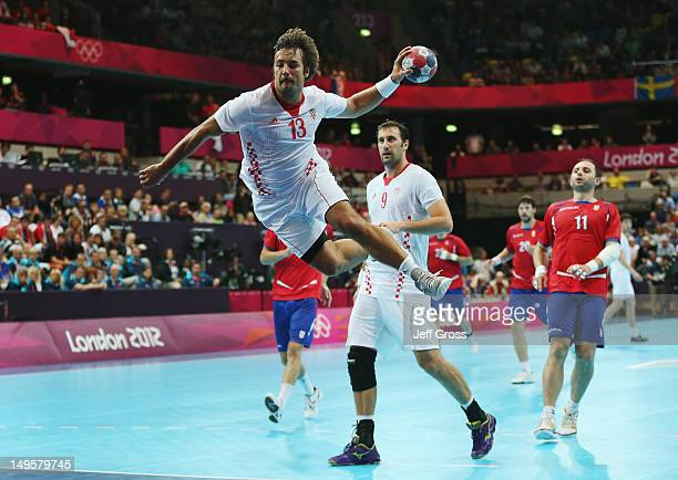Zlatko Horvat of Croatia shoots and scores during the Men's Handball Preliminary match between Serbia and Croatia on Day 4 of the London 2012 Olympic...