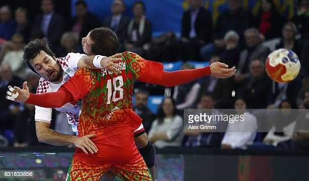 Zlatko Horvat of Croatia throws the ball past br8 of Belarus during the 25th IHF Men's World Championship 2017 match between Croatia and Belarus at...