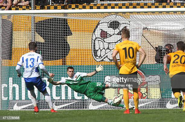 Zlatko Janijc of Duisburg scores the second goal after penalty during the third league match between SG Dynamo Dresden and MSV Duisburg at...