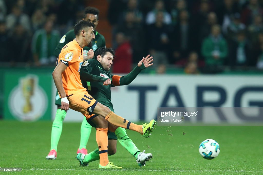 Zlatko Junuzovic of Bremen and Kerem Demirbay of Hoffenheim compete for the ball during the DFB Cup match between Werder Bremen and 1899 Hoffenheim at Weserstadion on October 25, 2017 in Bremen, Germany.