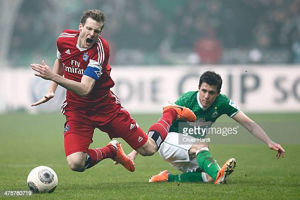 Zlatko Junuzovic of Bremen and Marcell Jansen of Hamburg compete for the ball during the Bundesliga match between Werder Bremen and Hamburger SV at...