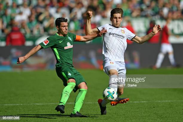Zlatko Junuzovic of Bremen and Panagiotis Retsos of Leverkusen fight for the ball during the Bundesliga match between SV Werder Bremen and Bayer 04...