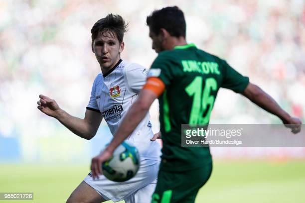 Zlatko Junuzovic of Bremen and Panagiotis Retsos of Leverkusen compete for the ball during the Bundesliga match between SV Werder Bremen and Bayer 04...