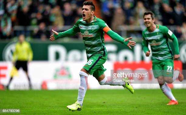 Zlatko Junuzovic of Bremen celebrates after scoring his teams first goal during the Bundesliga match between Werder Bremen and RB Leipzig at...