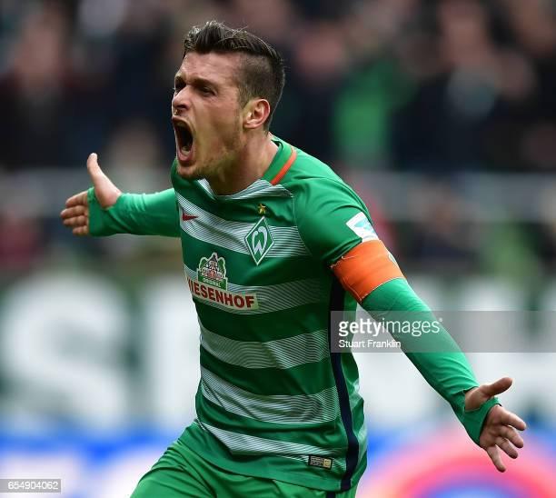 Zlatko Junuzovic of Bremen celebrates scoring his goal during the Bundesliga match between Werder Bremen and RB Leipzig at Weserstadion on March 18...