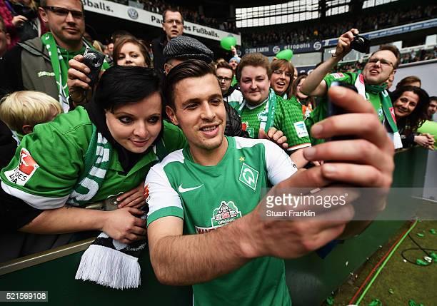 Zlatko Junuzovic of Bremen celebrates with fans after the Bundesliga match between Werder Bremen and VfL Wolfsburg at Weserstadion on April 16 2016...