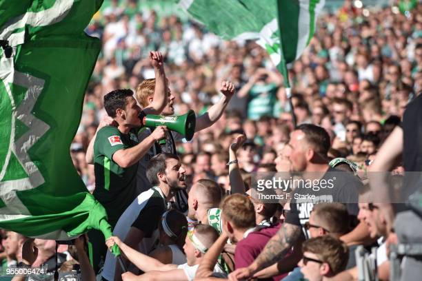 Zlatko Junuzovic of Bremen celebrates with the Bremen supporters during the Bundesliga match between SV Werder Bremen and Bayer 04 Leverkusen at...