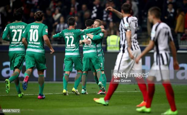 Zlatko Junuzovic of Bremen celebratw with his team mates after he scores the opening goal during the Bundesliga match between Eintracht Frankfurt and...