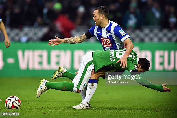 Zlatko Junuzovic of Bremen is challenged by Julian Schieber of Berlin during the Bundesliga match between SV Werder Bremen and Hertha BSC at...