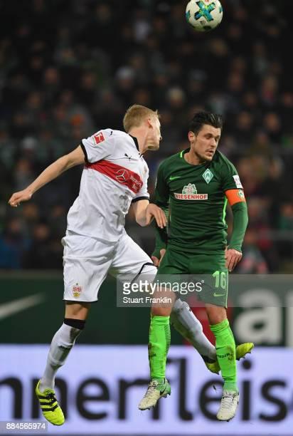 Zlatko Junuzovic of Bremen is challenged by Timo Baumgartl of Stuttgart during the Bundesliga match between SV Werder Bremen and VfB Stuttgart at...