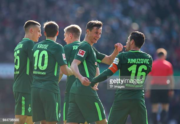 Zlatko Junuzovic of celebrates after scoring his team`s first goal with Maximilian Eggestein of Bremen Max Kruse of Bremen Aron Johannsson of Bremen...