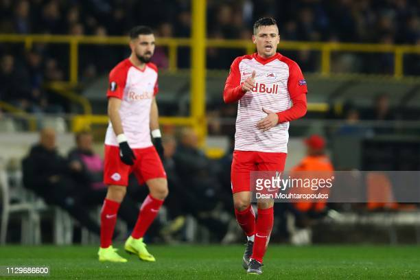 Zlatko Junuzovic of FC Salzburg after scoring his team's first goal during the UEFA Europa League Round of 32 First Leg match between Club Brugge and...