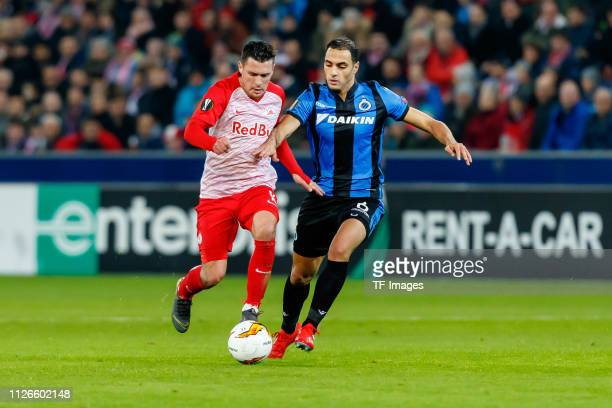 Zlatko Junuzovic of RB Salzburg and Sofyan Amrabat of Club Brugge battle for the ball during the UEFA Europa League Round of 32 Second Leg match...