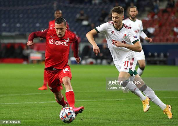 Zlatko Junuzovic of RB Salzburg battles for possession with Anton Miranchuk of Lokomotiv Moskva during the UEFA Champions League Group A stage match...