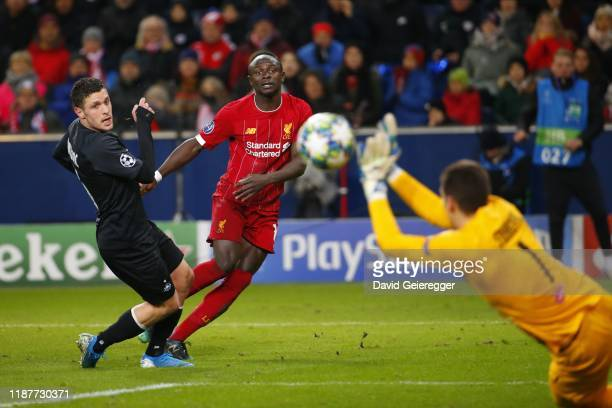 Zlatko Junuzovic of Salzburg and Sadio Mane of Liverpool watch the ball during the UEFA Champions League Group E match between FC Red Bull Salzburg...