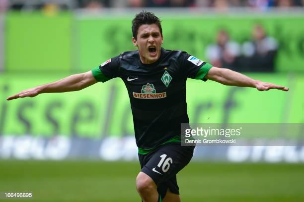 Zlatko Junuzovic of Werder Bremen celebrates after scoring his team's first goal during the Bundesliga match between Fortuna Duesseldorf 1895 and SV...