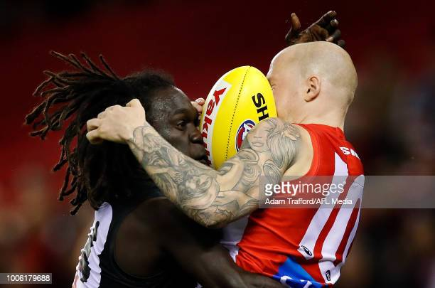 zm2es= and Zak Jones of the Swans compete for the ball during the 2018 AFL round 19 match between the Essendon Bombers and the Sydney Swans at Etihad...