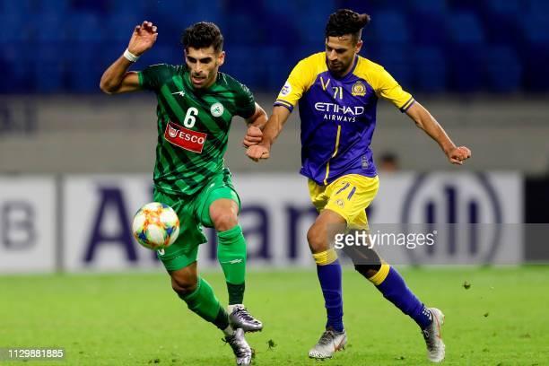 Zob Ahan's midfielder Hamid Bou Hamdan is marked by Nassr's forward Abdullah Al Salem during the AFC champions league Group A football match between...