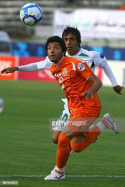 Zobahan's Esmail Farhadi approaches Mes Kerman's Mohammad Reza Torabi as he prepares to head the ball during their AFC Champions League round of 16...
