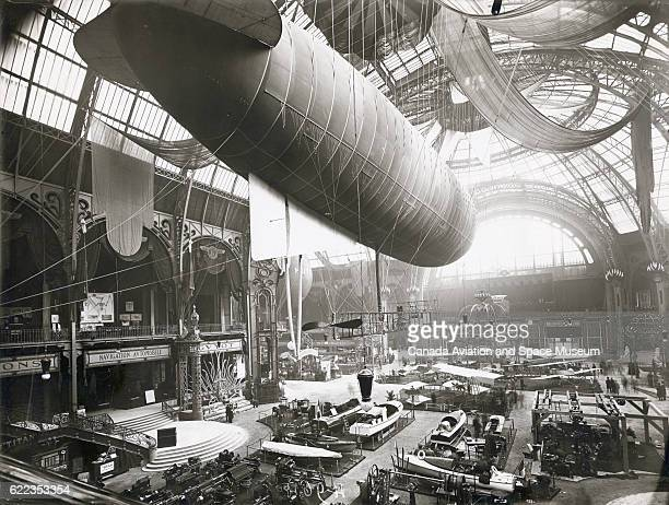 A Zodiac airship hangs from the ceiling of Paris' Grand Palais during the International Exposition of Aerial Locomotion of 1910