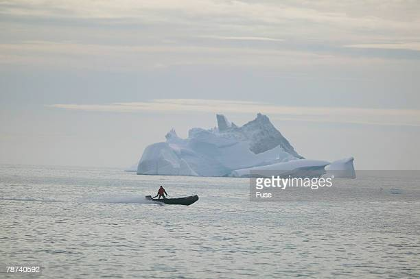 zodiac boat near an iceberg - mismatched clothes stock pictures, royalty-free photos & images