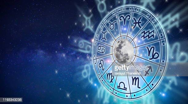zodiac signs inside of horoscope circle. astrology in the sky with many stars and moons  astrology and horoscopes concept - astronomie stock-fotos und bilder