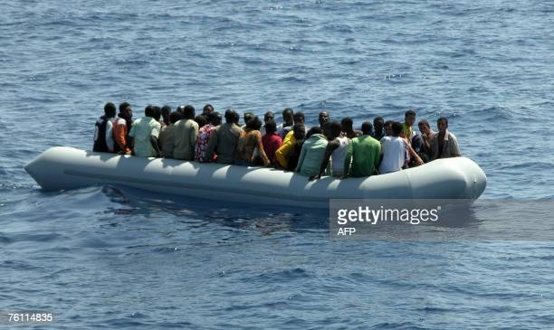A zodiac with 29 illegal male and 19 female Somalian immigrants is seen after being intercepted by the Italian Coast Guard 35 miles off Lampedusa...