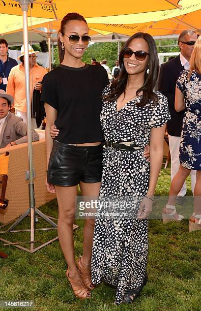 Zoe and Cisely Saldana pose at the VIP Marquee during the fifth Annual Veuve Clicquot Polo Classic on June 2, 2012 in Jersey City.
