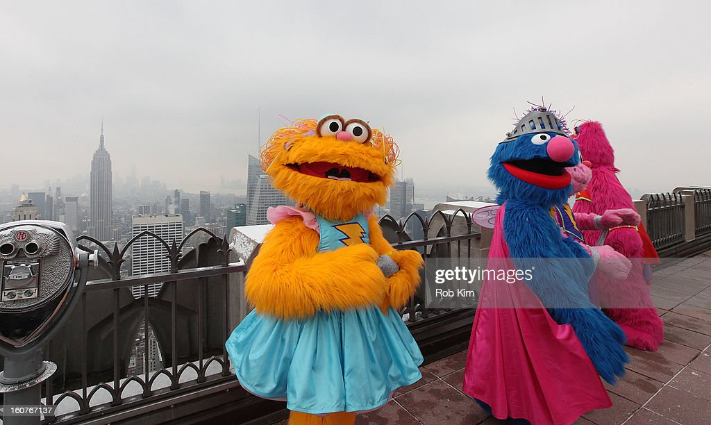 Zoe (L) and Super Grover visit the Top of the Rock Observation Deck at Rockefeller Center on February 5, 2013 in New York City.