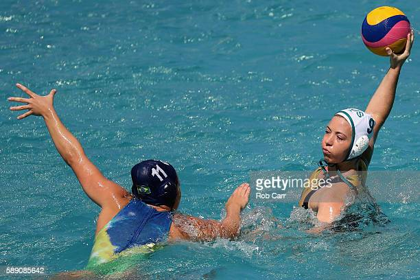 Zoe Arancini of Australia passes over Mariana Duarte of Brazil during the Womens Preliminaries on Day 8 of the Rio 2016 Olympic Games on August 13...