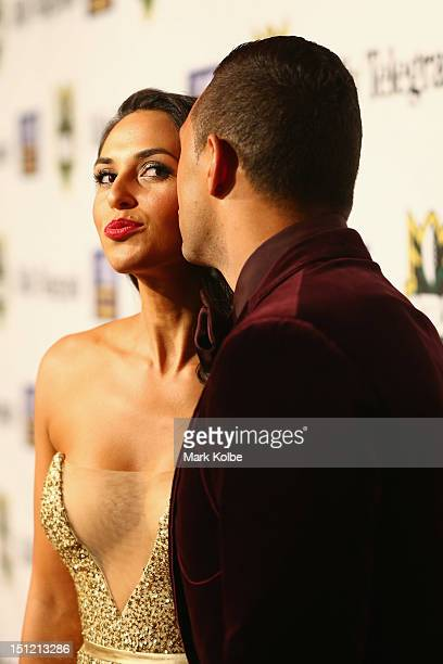 Zoe Balbi receives a kiss on the cheek from Benji Marshall as they pose on the red carpet as they arrive for the 2012 NRL Dally M Awards at Sydney...