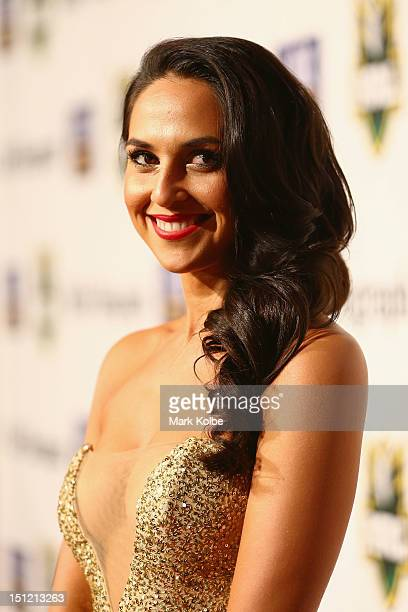 Zoe Balbi smiles as she looks at Benji Marshall as she poses on the red carpet as they arrive for the 2012 NRL Dally M Awards at Sydney Town Hall on...