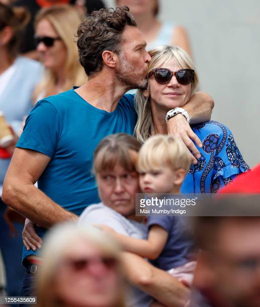 Zoe Ball and Michael Reed watch as Dame Vera Lynn's funeral cortege passes through her home village of Ditchling on route to her funeral on July 10,...