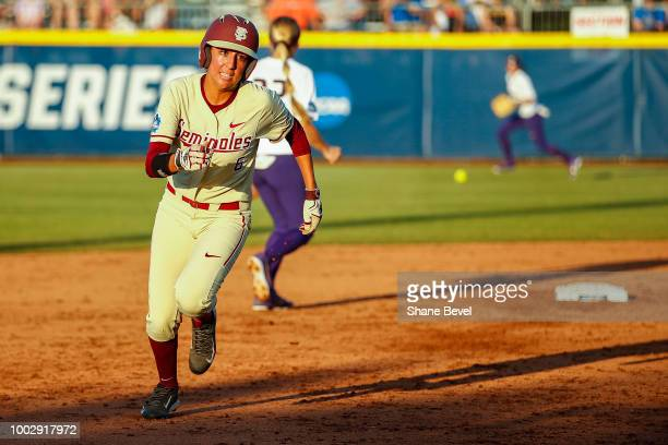 Zoe Casas of Florida State runs to third base during game two of the Division I Women's Softball Championship held at USA Softball Hall of Fame...