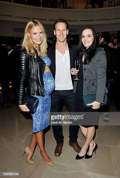 Zoe Cole Brendan Cole and Victoria Pendleton attend as Burberry celebrates The Britain at Burberry Regent Street on October 2 2012 in London England