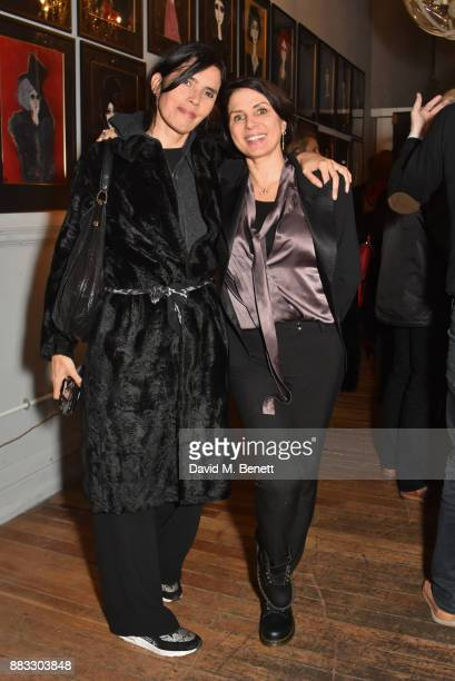 Zoe Grace and Sadie Frost attend a private view of artist Rebecca Leigh's exhibition hosted by Sadie Frost at Tann Rokka on November 30 2017 in...
