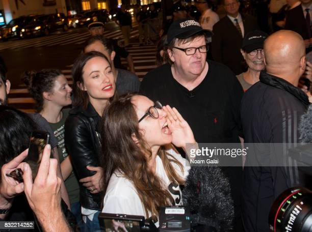 Zoe Kazan and Olivia Wilde join Michael Moore as he leads his Broadway audience to Trump Tower to protest President Donald Trump on August 15 2017 in...